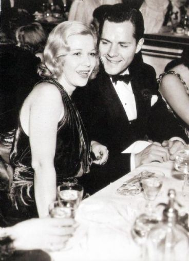 Glenda Farrell and Donald Woods, laughing gaily at the table. But do they really want to be there?