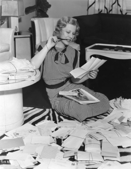 Glenda Farrell reading fan mail.