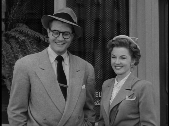 George Reeves as Clark Kent and Phyllis Coates as Lois Lane
